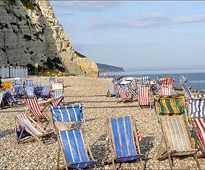 Deckchairs on the Devon beach